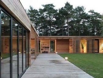 Виды проектов современных загородных домов с плоской крышей + фото планов и чертежей