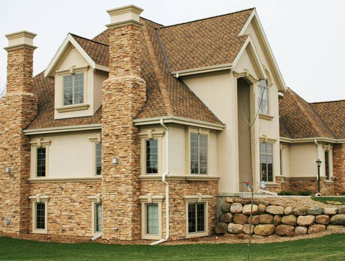 Фасадные панели под камень: виды и характеристики