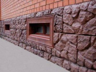 Цокольная плитка для облицовки фундамента дома: клинкерная, рваный камень, полимерпесчаная (фото, видео)
