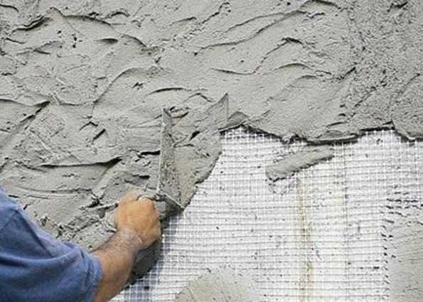 Способы оштукатуривания цоколя здания