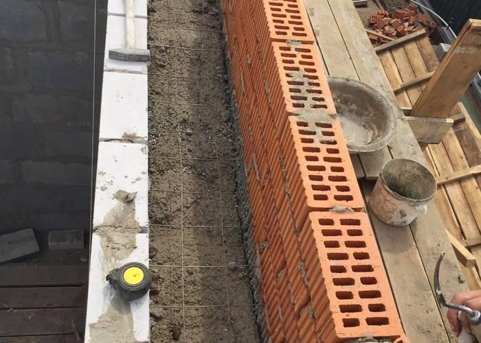 Стена из полистиролбетонных блоков: процесс укладки