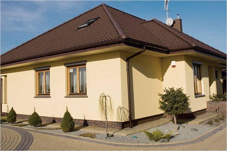 Окраска фасада дома: выбор краски и проведение работ