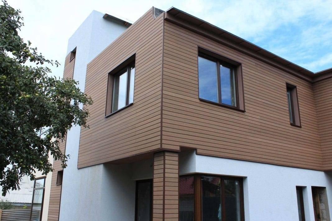 Обустройства фасада дома: сайдинг или штукатурка