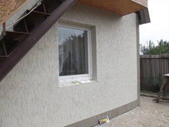 Отделка фасада дома декоративной штукатуркой: виды материала и технология нанесения