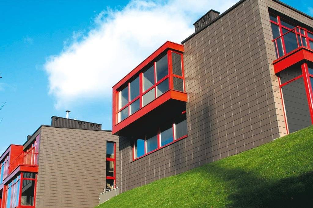 Облицовка фасада керамогранитом: виды керамической плитки, обзор производителей, технологии укладки
