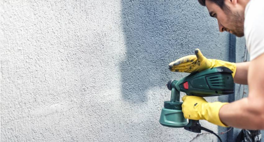 Фасадная краска по бетону: виды, выбор и применение