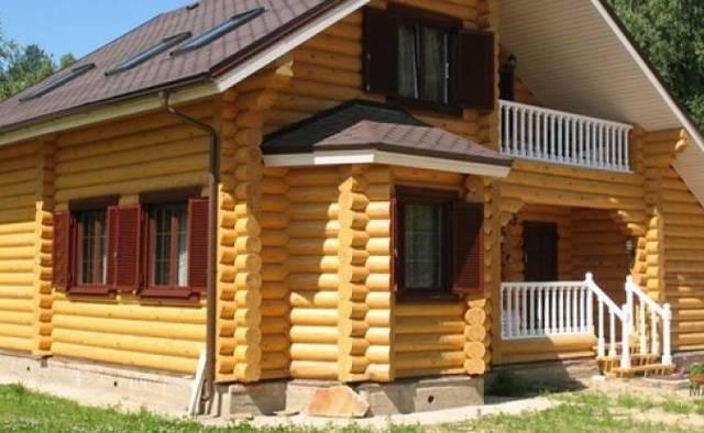 Строительство дома из оцилиндрованного бруса: нюансы, плюсы и минусы