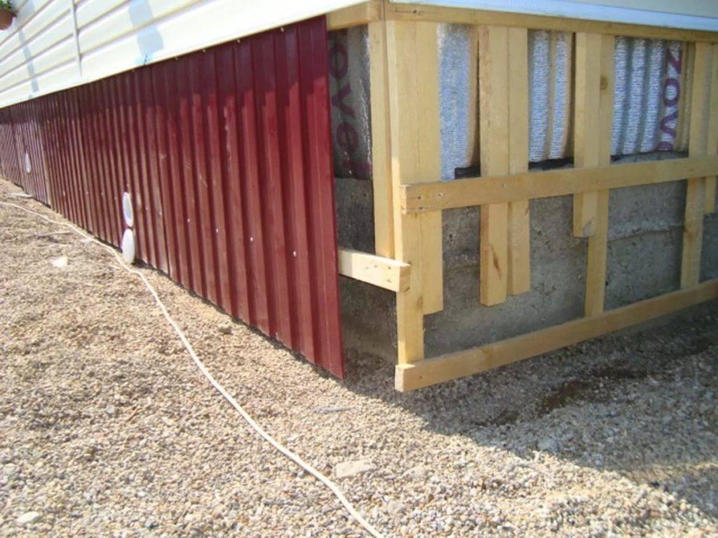 Как зашить низ дома между сваями. чем закрыть столбчатый фундамент снаружи