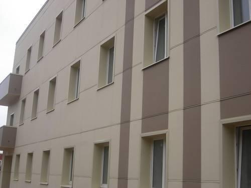 Облицовка зданий фиброцементными фасадными панелями